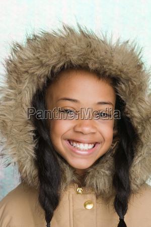 girl wearing coat with furry hood