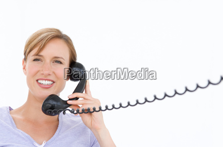 a businesswoman holding a telephone