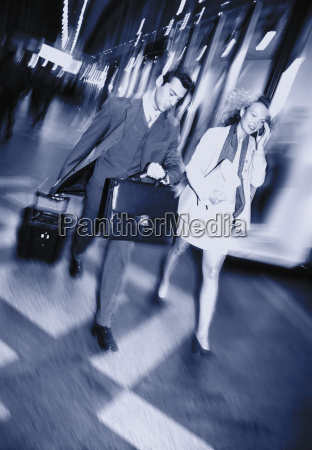 business couple on the move