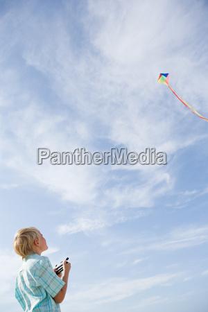 a boy flying a kite