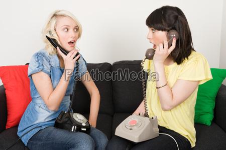 two women having telephone conversations