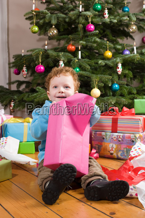 boy, opening, christmas, presents - 18601428