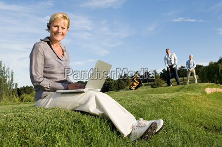 a businesswoman using a laptop on