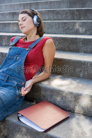 female student listening to music