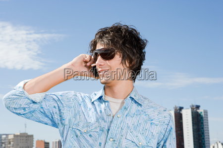 young man using a cellular telephone