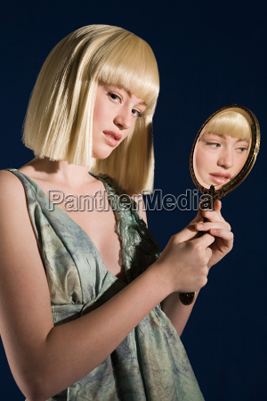 young woman with mirror