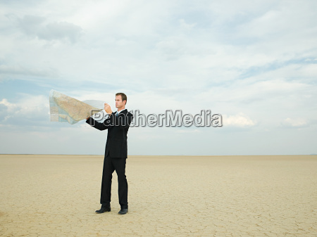 businessman looking at a map in