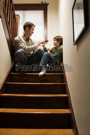 a father and son playing a