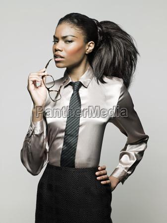 businesswoman, holding, glasses - 18605444