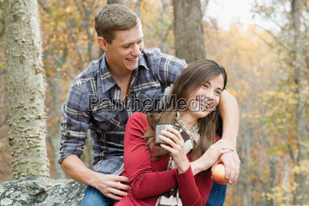 happy young couple in forest