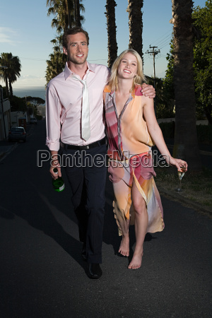 couple walking from party