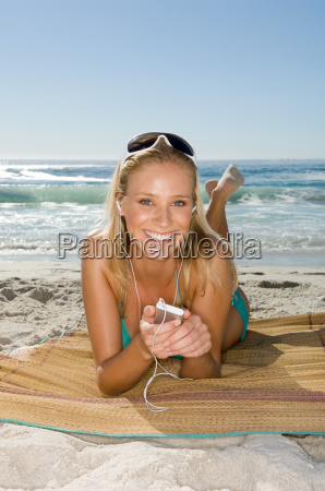young woman listening to mp3 player