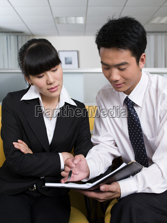 business colleagues with file