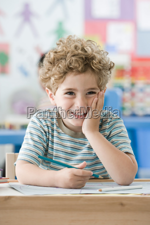 boy with hand on his face