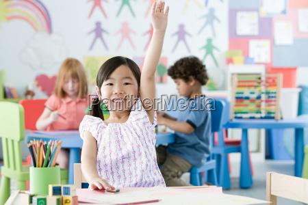 girl raising arm