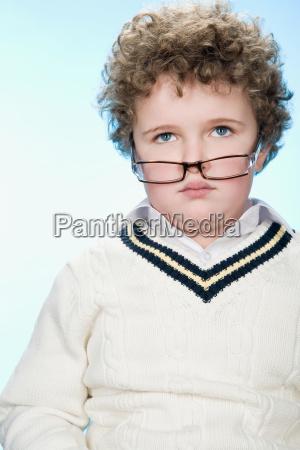 portrait of a boy wearing eyeglasses