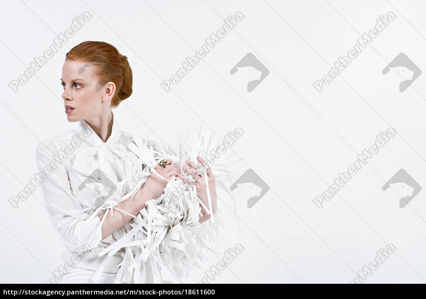 a, businesswoman, holding, shredded, paper - 18611600
