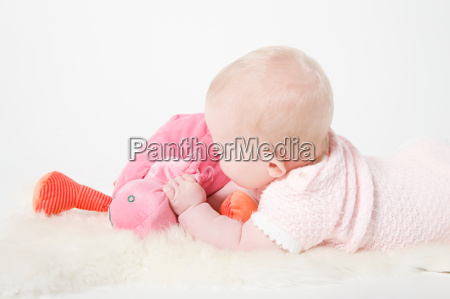baby girl holding a toy