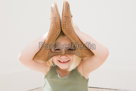 girl playing with a pair of