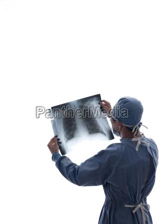 surgeon looking at x ray