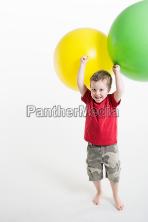 a boy playing with balloons