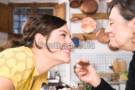 mother and daughter sampling food