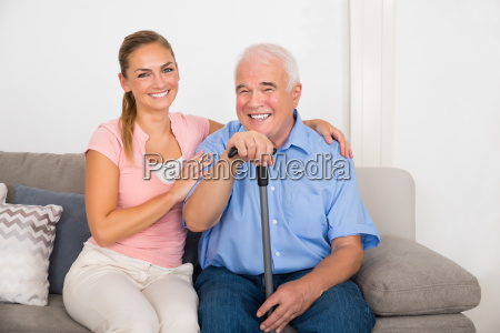 woman with her disabled father sitting