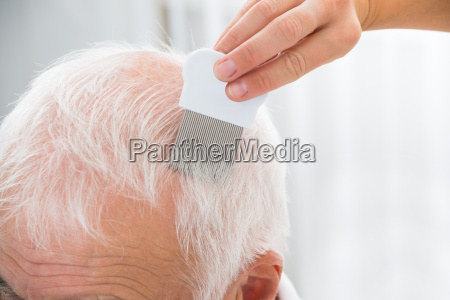 doctor doing treatment on patients hair