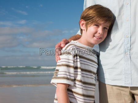 boy and father by the sea