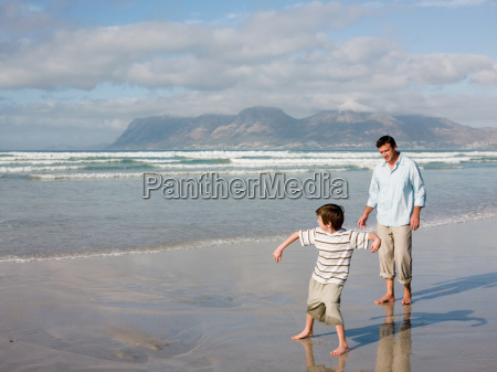 father and son throwing stones in