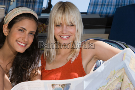 two young women and a map