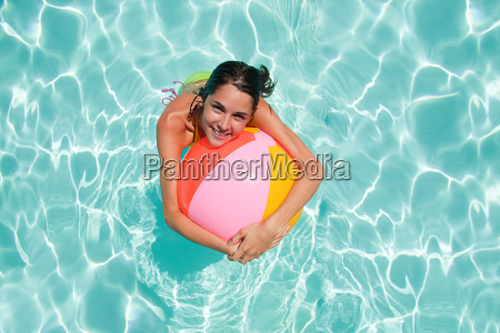 young woman in swimming pool with