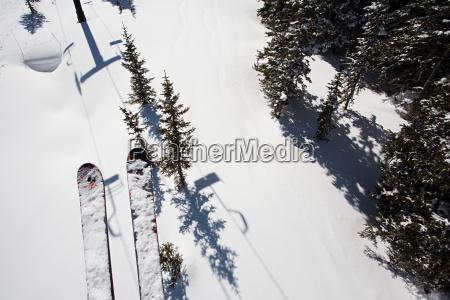 skis of skier on ski lift