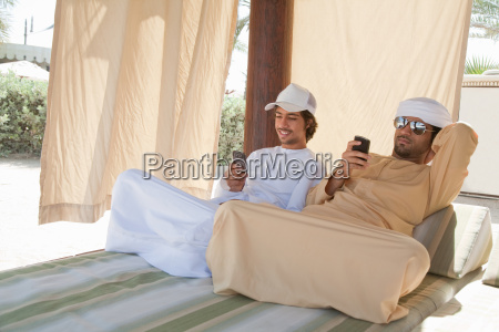 two middle eastern men sitting on