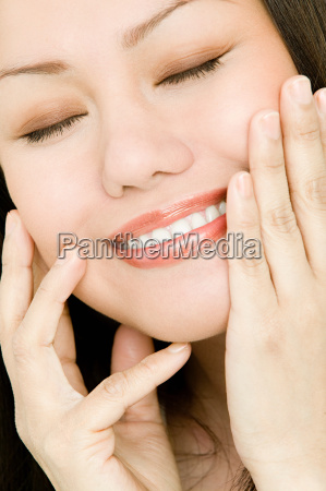 young woman touching face