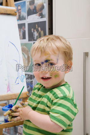 little boy with paint