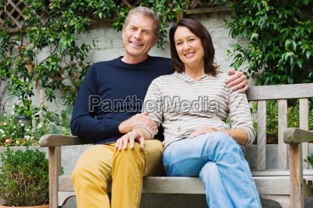 portrait of a couple sat on