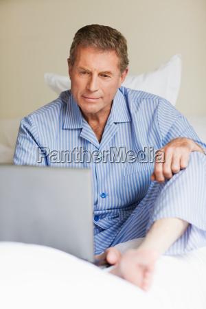senior man using a laptop in