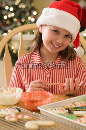 girl making christmas cookies