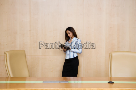 businesswoman in a conference room