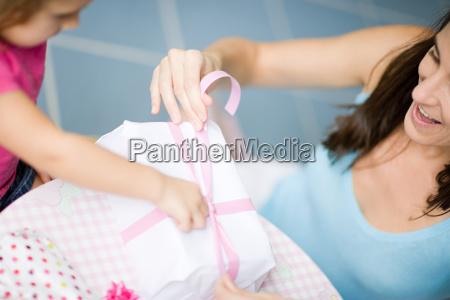 girl and mother with birthday gift