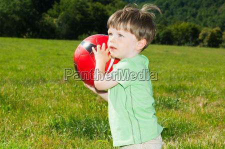 boy holding football portrait