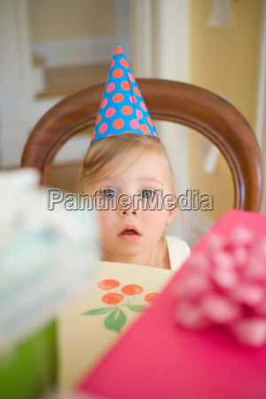 little girl wearing party hat