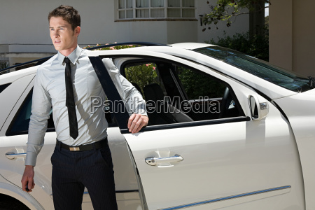 young man by car