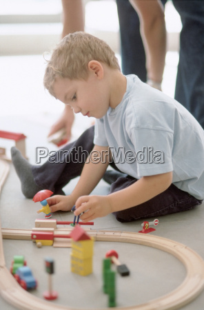 boy playing with model railway