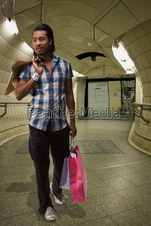 a young man carrying shopping bags