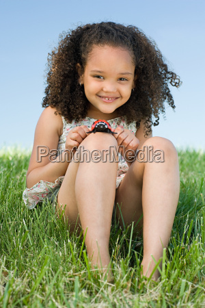 girl with a toy ladybird