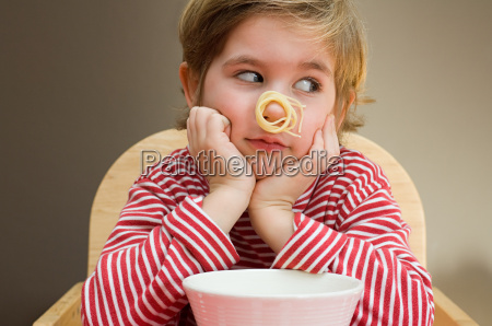 boy with spaghetti on his nose