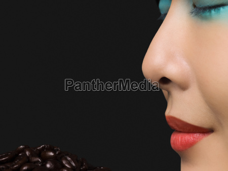 woman smelling coffee beans