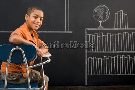 portrait of a boy sat at